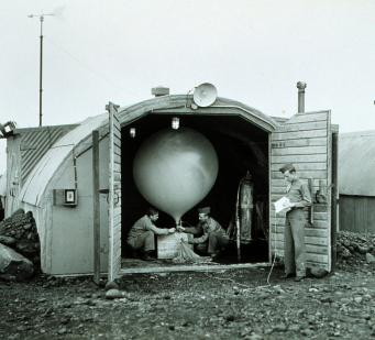 Army Air Force meteorologists prepare to launch a hydrogen-filled balloon that will carry a radiosonde up in the air to measure temperature, humidity, and atmospheric pressure and transmit the data back to a ground station. Courtesy of the NOAA Photo Library.