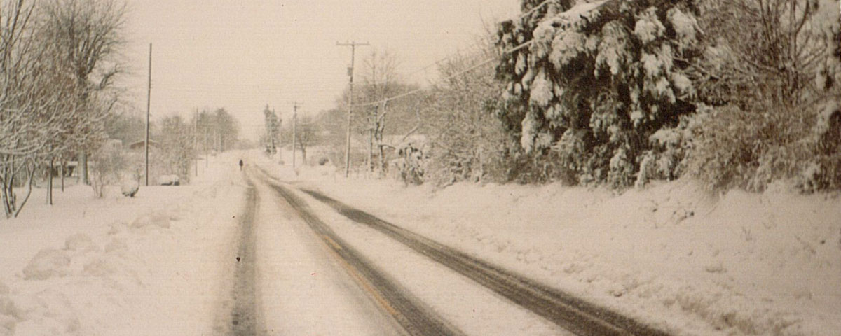 Photo of snow accumulation on a road in western North Carolina in March 1993