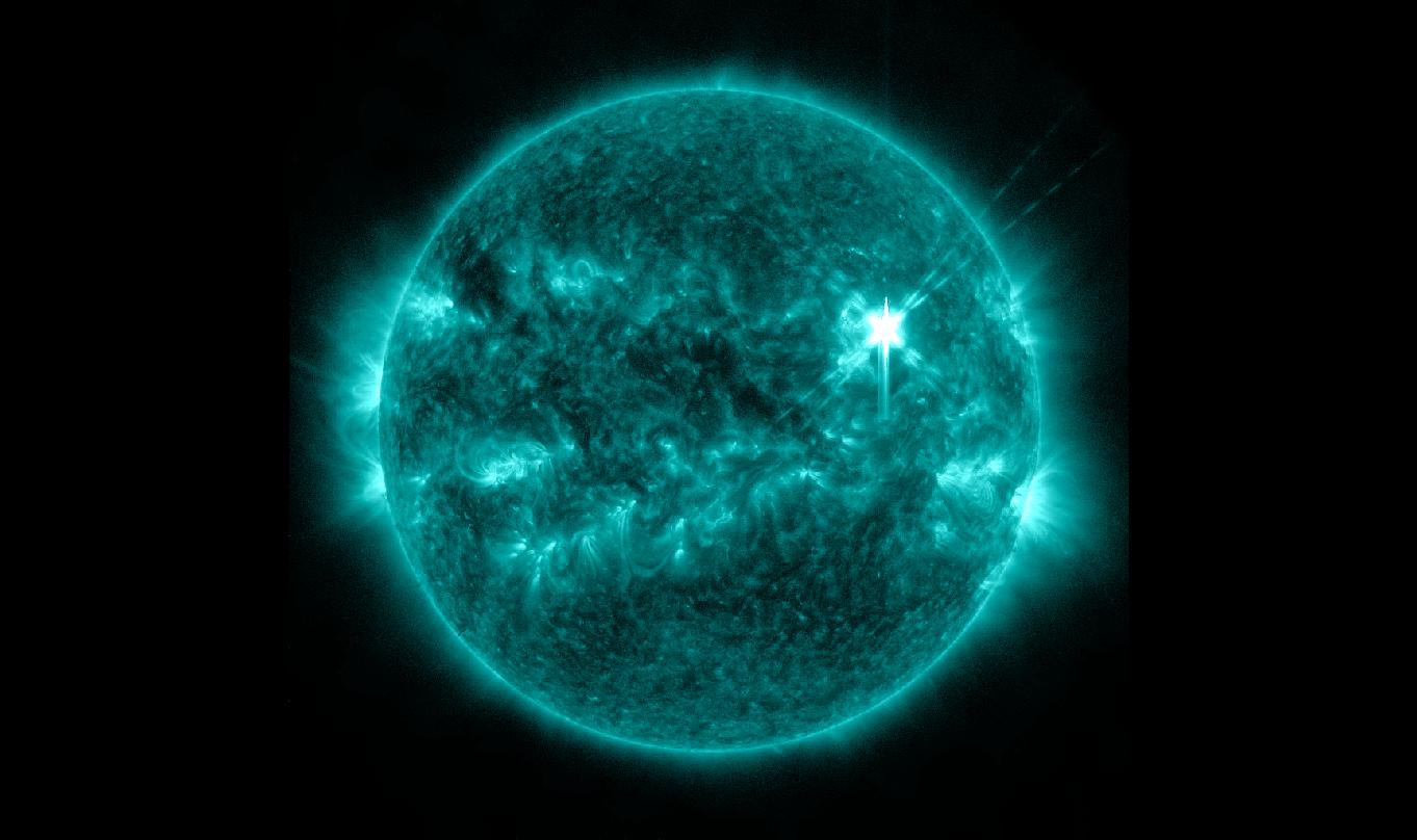 Solar flare blazingly hot in the upper right of the sun. Credit: NASA/SDO/AIA