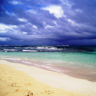 Photo of beach in Puerto Rico with rain clouds