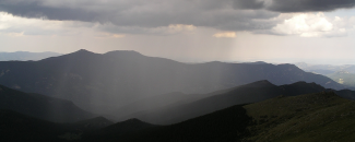 Photo of rain over the mountains in Colorado