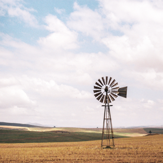 Picture of a windmill in a dry field