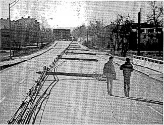 Picture of toppled electrical poles from Chinook wind event of January 1982 in Boulder.