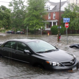 Photo of cars flooded in city street