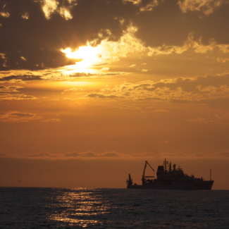 Photo of NOAA ship Pisces at sunset