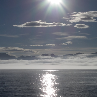 Photo of sun over Prince William Sound