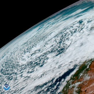 Satellite photo of heavy rain and snow over Pacific Northwest USA