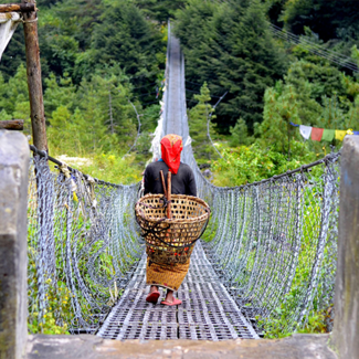 Woman crossing a bridge in Nepal