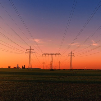 Photo of red sunset and electrical lines