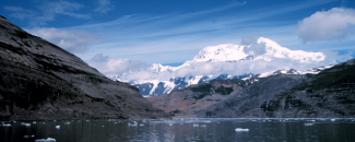 Photo of snow-covered Mount St. Elias from Icy Bay, South Central Alaska