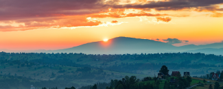 Photo of a sunset over mountains in Poland