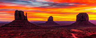 Photo of a sunset in Monument Valley Utah