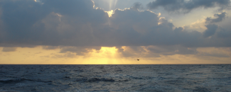 Photo of ocean, clouds, sun from NOAA Photo Library.