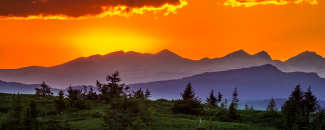Photo of a sunset over mountains