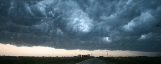 Banner image of dark supercell storm cloud near Enid, Oklahoma, from NOAA