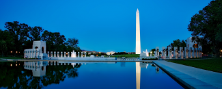Photo of Washington Monument at night with reflection in pool