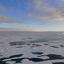 Photo of an Arctic landscape of ice floes and melt pools