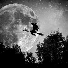 Artwork of a witch flying in front of a full moon