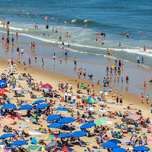 Photo of a crowded beach covered with umbrellas in Ocean City, Maryland, courtesy of iStock
