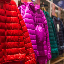 Photo of down jackets in a retail clothing store