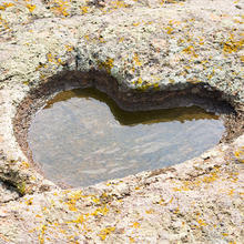 Photo of a heart carved into rock courtesy of iStock