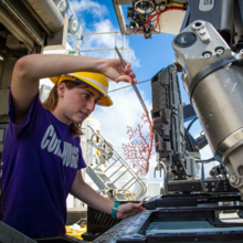 Image of NCEI scientist on Okeanos expedition by NOAA OER