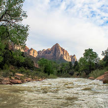 Photo of a river in front of the Zion Mountains in Utah