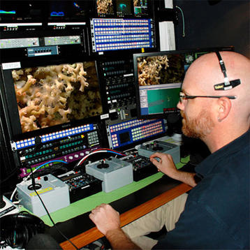 Photo of scientist collecting data on board the NOAA ship Okeanos Explorer