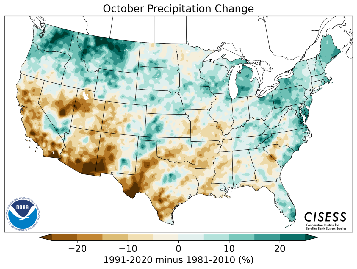 A map of the contiguous United States showing the pattern of October precipitation change for 1991–2020 Normals minus the 1981–2010 Normals. Colors range from brown for drier normals (-20%) through tan and light green near zero difference to green for wetter normals (+20%). The northern third of the U.S. has wetter normals now than previously, especially in the Northwest (WA, OR, ID, MT, WY). The southwest and south-central U.S. are generally drier in the new normals, with less distinct patterns in the rest of the eastern U.S.