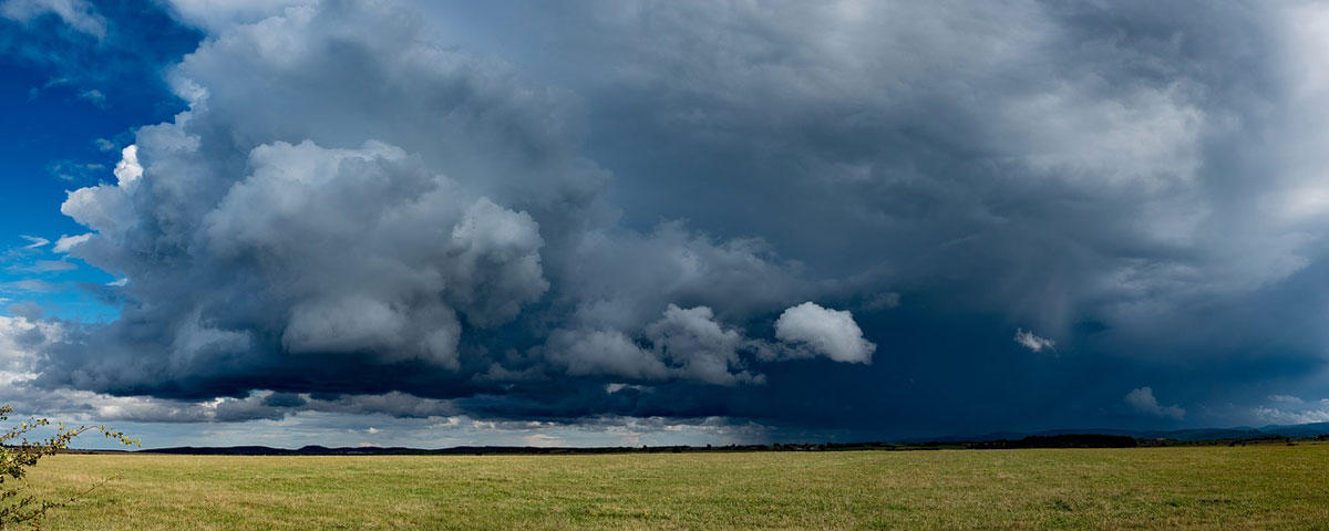 Photo of storm clouds over a field
